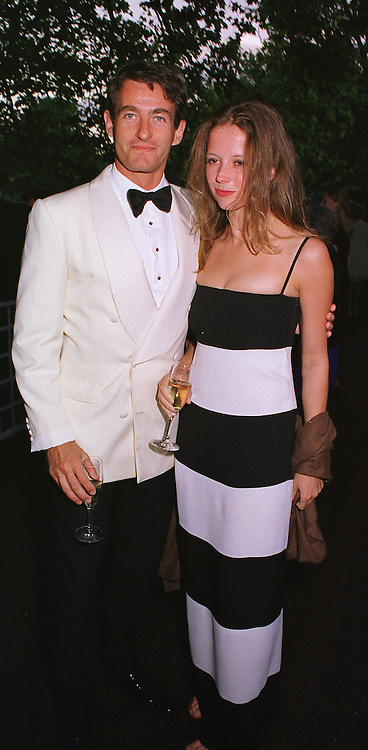 MISS CATHERINE BOOTH and MR TIM JEFFERIES, at a party in London on 5th June 1999.MSX 128