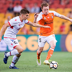 BRISBANE, AUSTRALIA - OCTOBER 13: Corey Brown of the Roar and Nathan Konstandopoulos of Adelaide compete for the ball during the Round 2 Hyundai A-League match between Brisbane Roar and Adelaide United on October 13, 2017 in Brisbane, Australia. (Photo by Patrick Kearney)