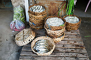 Fish for sale displayed in bamboo baskets at Daeum Kor morning market in Phnom Penh, the capital city of Cambodia. A large variety of local products are available for sale in fresh markets all over Cambodia, all being sold on small individual stalls.