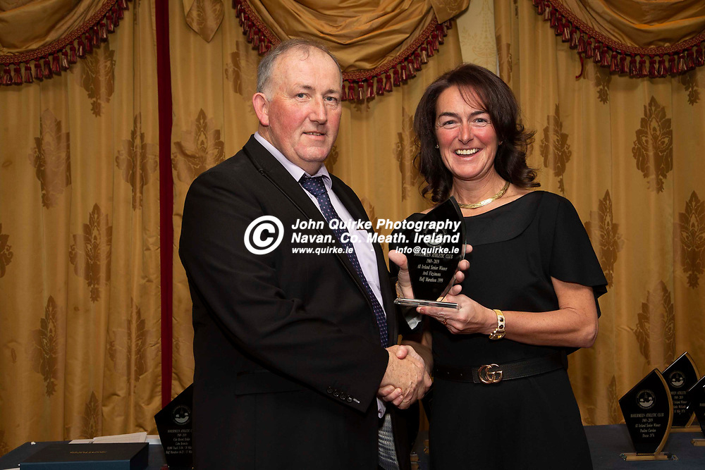 27/10/2019, Bohermeen Athletic Club 50th Anniversary celebration at the Ardboyne Hotel, Navan.<br /> Stephen Ball (Chairperson) makes a presentation to Avril Fitzsimons - All Ireland Senior Winner<br /> Photo: David Mullen / www.quirke.ie ©John Quirke Photography, Unit 17, Blackcastle Shopping Cte. Navan. Co. Meath. 046-9079044 / 087-2579454.<br /> ISO: 400; Shutter: 1/200; Aperture: 6.3; <br /> File Size: 2.6MB