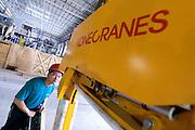 Kone Cranes' Automation Designer Minh KY checks an Heavy Duty Semi-Automatic 60 + 60 ton Kone Crane in Oji Paper Factory, in Nantong, Jiangsu province, China, on May 25, 2010. Photo by Lucas Schifres/Pictobank