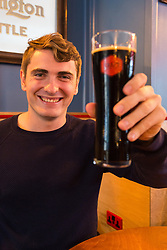 Aspiring actor Will Pyke, 24, from Brisbane in Australia enjoys a £22.50 pint of Alesmith's Speedway at the Craft Beer Co's pub in Old Street, Hoxton, which has a vast range of beers from small brewers around the world. London, August 26 2018.
