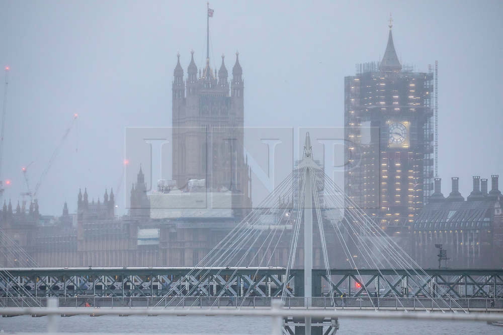 © Licensed to London News Pictures. 13/01/2020. London, UK. Misty rain across the Houses of Parliament this evening as London braces for high winds and heavy squally rain during this evening's rush hour. Storm Brendan is forecast to blow in towards the South East with winds expected to peak up to 45mph. Photo credit: Alex Lentati/LNP