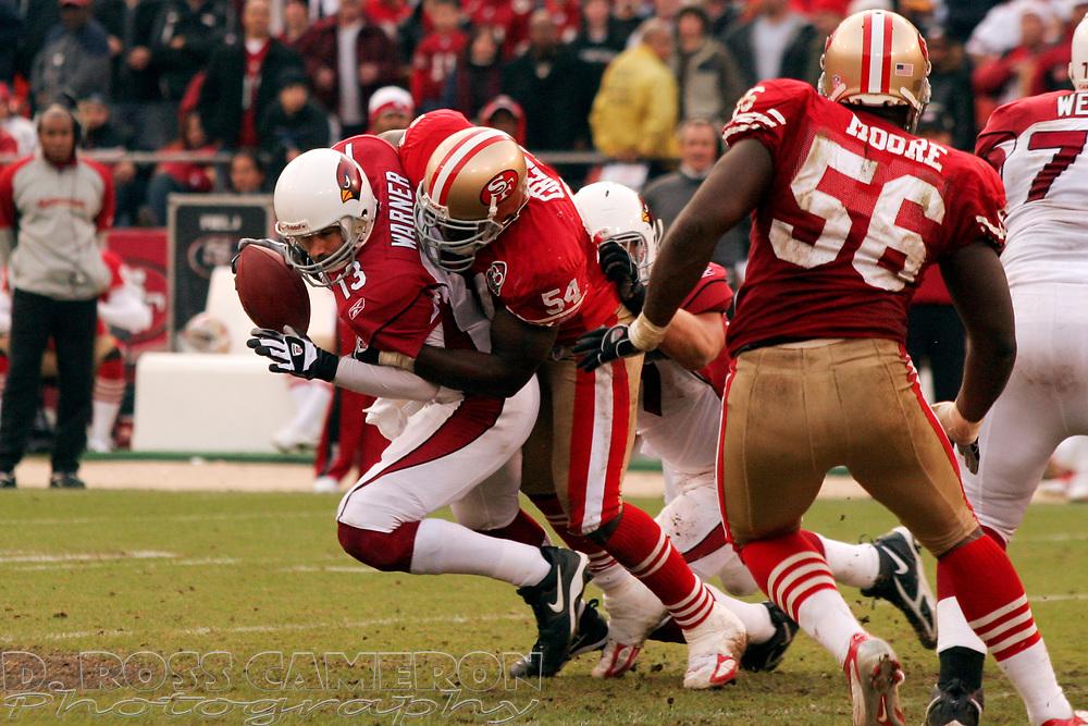 San Francisco 49ers' Hannibal Navies (54) sacks Arizona Cardinals quarterback Kurt Warner in the fourth quarter of their NFL football game, Sunday, Dec. 24, 2006 at Candlestick Park in San Francisco.  The Cardinals won, 26-20. (D. Ross Cameron/The Oakland Tribune)