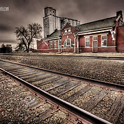 Cloudy sunrise near the old train depot and grail elevators in Stafford, Kansas