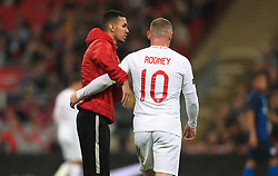 England's Wayne Rooney (right) with a pitch invader during the International Friendly at Wembley Stadium, London. PRESS ASSOCIATION Photo. Picture date: Thursday November 15, 2018. See PA story SOCCER England. Photo credit should read: Mike Egerton/PA Wire. RESTRICTIONS: Use subject to FA restrictions. Editorial use only. Commercial use only with prior written consent of the FA. No editing except cropping.