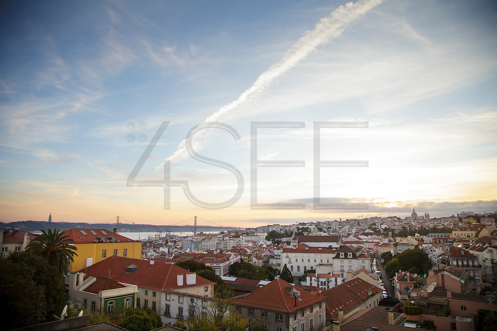 """The view from one f the balconies in one of the rooms at hotel """"Casa das Janelas com Vista"""", where 25th of April bridge and the summit of Basilica da Estrea can be seen."""