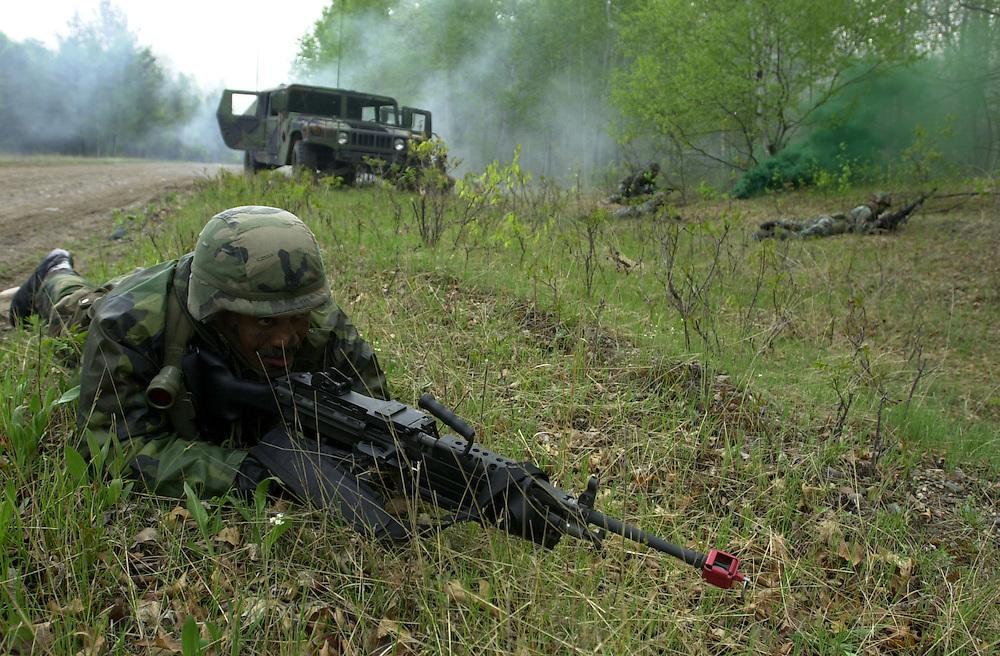 Michigan National Guard soldiers simulate humvee ambushes at Camp Ripley in Minnesota.