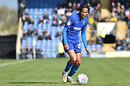 AFC Wimbledon defender Toby Sibbick (20) sprints forward with the ball during the EFL Sky Bet League 1 match between Oxford United and AFC Wimbledon at the Kassam Stadium, Oxford, England on 13 April 2019.