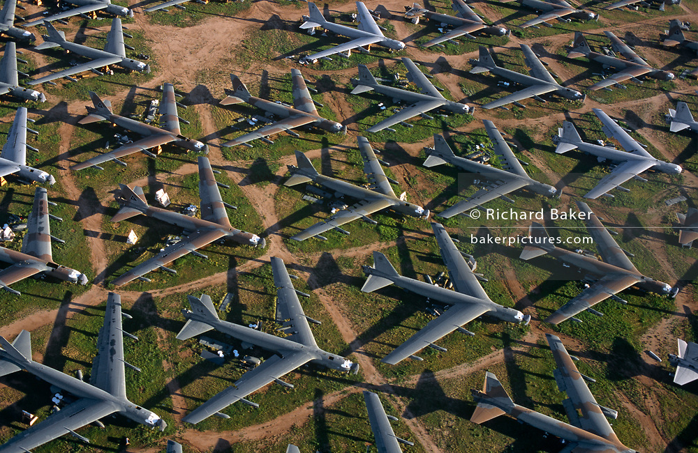 Awaiting recycling and destruction are Boeing B-52 bombers from the Cold War era, now aluminium junk in the arid desert, on 15th August 1998, at Davis Monthan Air Force Base, Tucson, Arizona, USA.