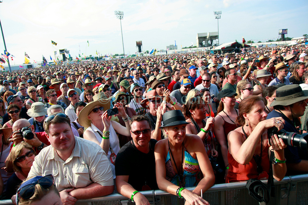 27 April 2013. New Orleans, Louisiana,  USA. .New Orleans Jazz and Heritage Festival. Fans pack the grounds for Billy Joel as he takes to the Acura stage..Photo; Charlie Varley.
