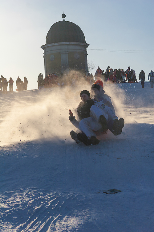 Sledging on Shrove Tuesday in Helsinki, Finland. In Finland the day is generally celebrated by eating green pea soup.  and a pastry called laskiaispulla (sweet bread filled with whipped cream and jam or almond paste). The celebration often includes sledging.