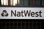 Sign for Nat West Bank in the City of London. National Westminster Bank Plc, commonly known as NatWest, is the largest retail and commercial bank in the United Kingdom and has been part of The Royal Bank of Scotland Group Plc since 2000.