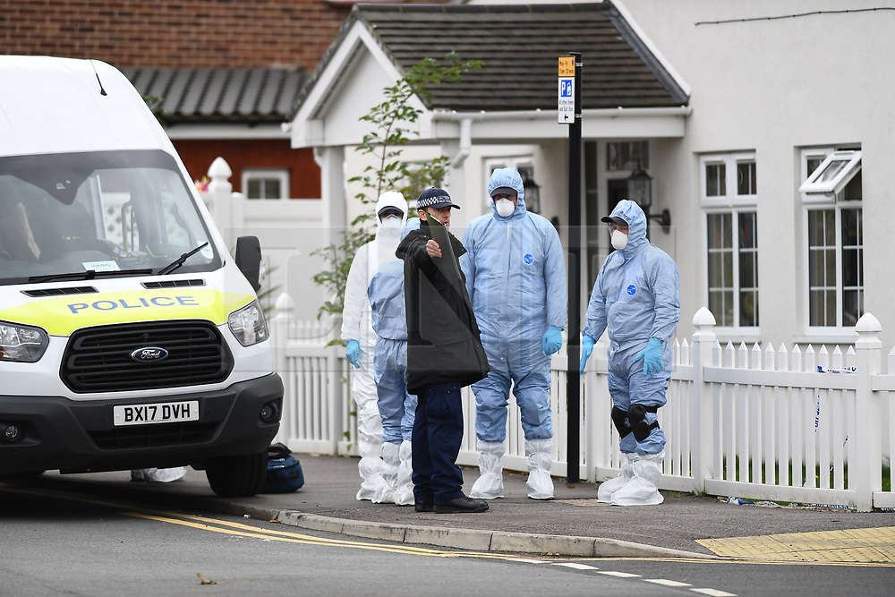 © Licensed to London News Pictures.  06/10/2020. London, UK. Forensics officers examine the crime scene as police launch a murder investigation in Ilford, East London after a male in his thirties was found in Southdown Crescent at around 9.30pm with stab wounds. He was declared dead at the scene: Photo credit, Steve Poston/LNP