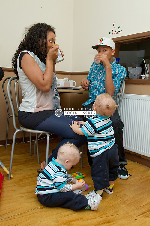 Small twin boys with mother and older brother. (This photo has extra clearance covering Homelessness, Mental Health Issues, Bullying, Education and Exclusion, as well as the usual clearance for Fostering & Adoption and general Social Services contexts,)