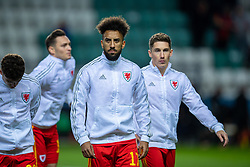 TALLINN, ESTONIA - Monday, October 11, 2021: Wales' Sorba Thomas (L) and Harry Wilson line-up before the FIFA World Cup Qatar 2022 Qualifying Group E match between Estonia and Wales at the A. Le Coq Arena. Wales won 1-0. (Pic by David Rawcliffe/Propaganda)