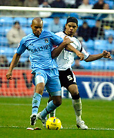 Photo: Ed Godden.<br />Coventry City v Derby County. Coca Cola Championship. 11/11/2006. Coventry's Leon McKenzie (L), holds off Dean Leacock.