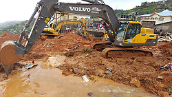 (170815) -- FREETOWN, Aug. 15, 2017 (Xinhua) -- Rescuers and a mechanical digger work at the site of mudslide during a rescue operation in Freetown, Sierra Leone, on Aug. 14, 2017. Government of Sierra Leone is expected on Tuesday to undertake the burial of the majority of corpses of victims in the devastating mudslide which had claimed nearly 300 lives, sources close to the government told Xinhua.  (Xinhua/Liu Yu) (zf) (Photo by Xinhua/Sipa USA)