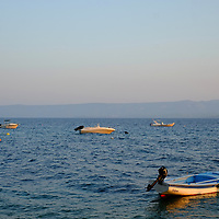 Small boats in the harbour at sunset;<br />Bol, Brac, Croatia.