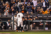 San Francisco Giants manager Bruce Bochy (15) gives first baseman Brandon Belt (9) a high five after scoring a run against the Colorado Rockies at AT&T Park in San Francisco, Calif., on September 27, 2016. (Stan Olszewski/Special to S.F. Examiner)