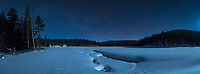 Several feet of dry powdery snow covered the ice at Sibley Lake. It was nearly 4AM on the longest night of the year and the crescent moon was lighting up the cold scene.