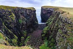 Dramatic cliffs at Calder's Geo on coast at Eshaness at Northmavine , north mainland of Shetland Islands, Scotland, UK