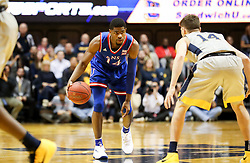 Jan 15, 2018; Morgantown, WV, USA; Kansas Jayhawks guard Malik Newman (14) dribbles during the first half against the West Virginia Mountaineers at WVU Coliseum. Mandatory Credit: Ben Queen-USA TODAY Sports