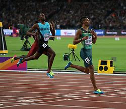 London, August 08 2017 . Wayde van Niekerk, South Africa, wins the men's 400m final ahead of Steven Gardiner, Bahamas, and Abdalelah Haroun, Qatar, on day five of the IAAF London 2017 world Championships at the London Stadium. © Paul Davey.