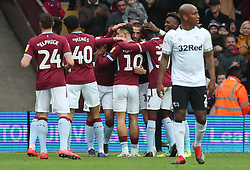 Aston Villa's Conor Hourihane (hidden) is congratulated by team mates after scoring his side's first goal during the Sky Bet Championship match at Villa Park Birmingham.