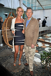 NATASHA THOMAS and JOHN STEVENS at the Total Concierge launch party held in the stylish Courtyard Garden at Sanderson, Berners Street, London on 26th May 2009.
