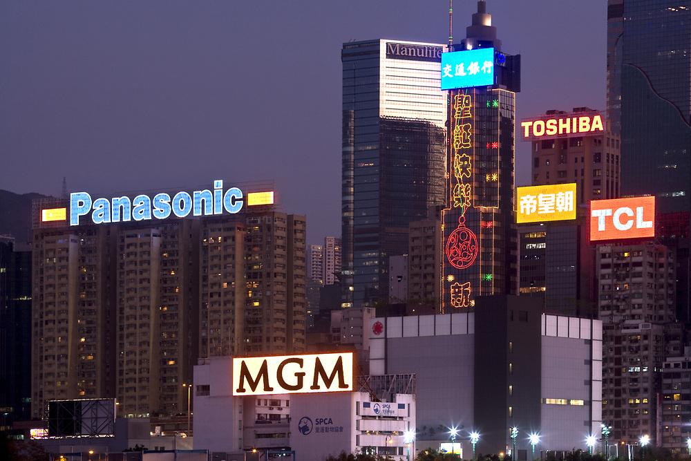 Victoria Harbour, Hong Kong Island, Hong Kong, China, Asia - Advertising signs and Christmas lights on the facades of buildings at Wan Chai in Hong Kong.