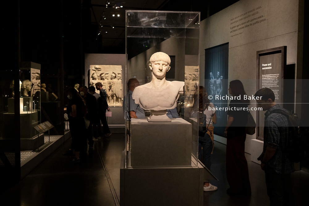 """Visitors to the (Roman Emperor) Nero exhibition, """"The Man Behnd The Myth"""", read descriptions and learn about the Julio-Claudian dynasty of ancient Rome at the British Museum, on 26th September 2021, in London, England. """"Nero is known as one of Rome's most infamous rulers, notorious for his cruelty, debauchery and madness. The last male descendant of the emperor Augustus, Nero succeeded to the throne in AD 54 aged just 16 and died a violent death at 30. His turbulent rule saw momentous events including the Great Fire of Rome, Boudicca's rebellion in Britain, the execution of his own mother and first wife, grand projects and extravagant excesses. Drawing on the latest research, this major exhibition questions the traditional narrative of the ruthless tyrant and eccentric performer, revealing a different Nero, a populist leader at a time of great change in Roman society."""""""