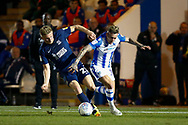 Southend United defender Taylor Moore makes a tackle on Colchester United midfielder Sammie Szmodics (10) during the EFL Trophy match between Colchester United and Southend United at the Weston Homes Community Stadium, Colchester, England on 9 October 2018.