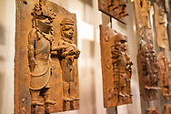 London. England. Benin Bronzes on display at the British Museum, brass plaques from the royal court palace of the Kingdom of Benin, 16-17th century