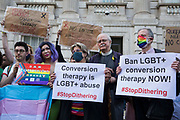 Campaigners against LGBT+ conversion therapy, including Jayne Ozanne of the Ban Conversion Therapy Coalition c and veteran LGBT+ and human rights campaigner Peter Tatchell r, attend a picket outside the Cabinet Office and Government Equalities Office on 23rd June 2021 in London, United Kingdom. They also handed in a petition signed by 7,500 people calling on the government to fulfil its promise made in July 2018 to ban LGBT+ conversion therapy. LGBT+ conversion treatments, which have been linked to anxiety, depression and self-harm, have been condemned by major UK medical, psychological and counselling organisations.