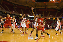 26 February 2009: Raisa Taylor edges into the lane as Kenyatta Shelton defends the goal. The Braves of Bradley  and the Illinois State Redbirds battled it out on Doug Collins Court inside Redbird Arena on the campus of Illinois State University, Normal Il.