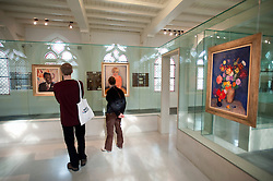 Visitors looking at paintings from van Baaren collection at Centraal Museum in Utrecht in The Netherlands