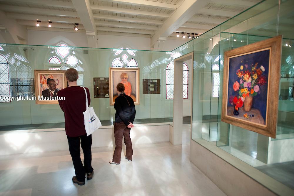 Visitors looking at paintings from van Baaren collection at Centraal Museum in Utrecht in The Netherlands