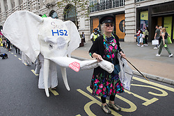 Dorothea Hackman, chair of Camden Civic Society, leads the Stop HS2 white elephant on the Extinction Rebellion March for Nature on the final day of their two-week Impossible Rebellion on 4th September 2021 in London, United Kingdom. Extinction Rebellion are calling on the UK government to cease all new fossil fuel investment with immediate effect.