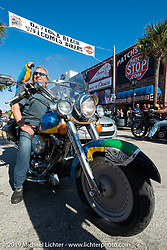 """Spyke Molarz on his '96 """"Fat Bird"""" with his pet bird that always rides with him on the final Saturday of Daytona Bike Week. FL, USA. March 15, 2014.  Photography ©2014 Michael Lichter."""