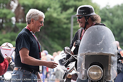 Rowdy Schenck on his 1928 Harley-Davidson JD checks in with John Classen and Jim Feeney at the finish in Keane during the Motorcycle Cannonball coast to coast vintage run. Stage-1 (145-miles) from Portland, Maine to Keene, NH. Saturday September 8, 2018. Photography ©2018 Michael Lichter.