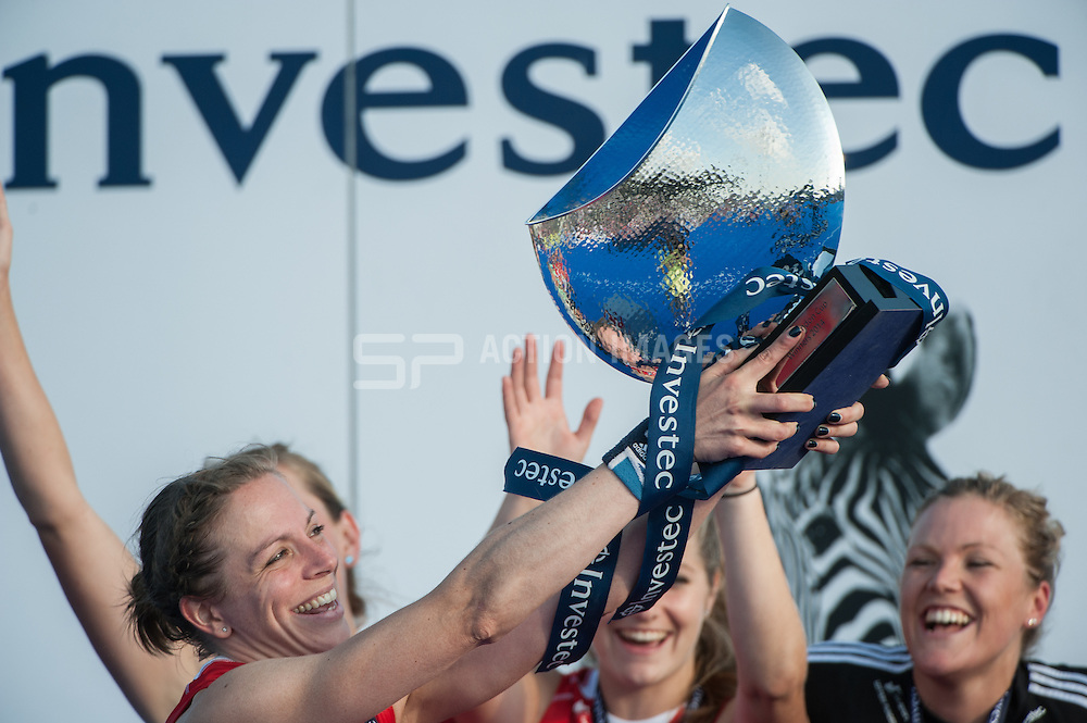 England's Kate Richardson-Walsh holds the winners trophy aloft after the Final of the Investec London Cup. Lee Valley Hockey & Tennis Centre, London, UK on 13 July 2014. Photo: Simon Parker