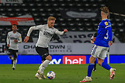 Kamil Jozwiak of Derby County (7) takes on Cardiff City defender Joe Bennett (3) during the EFL Sky Bet Championship match between Derby County and Cardiff City at the Pride Park, Derby, England on 28 October 2020.