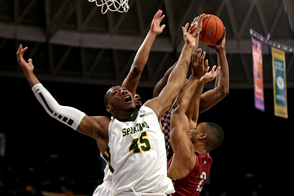 Mar 16, 2019; Norfolk, VA, USA; Norfolk State Spartans forward Jordan Butler (45) and North Carolina Central Eagles forward Jibri Blount (2) go for a rebound during the second half in the MEAC Tournament Final at The Scope. Mandatory Credit: Peter Casey-USA TODAY Sports