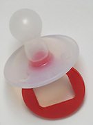 plastic pacifier on a white background