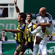 Kasimpasaspor's Mustafa Koray AVCI (R) and Fenerbahce's Selcuk SAHIN (L) during their Turkish superleague soccer match Kasimpasaspor between Fenerbahce at the Recep Tayyip Erdogan stadium in Istanbul Turkey on Sunday 25 April 2010. Photo by TURKPIX