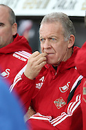 Swansea city caretaker manager Alan Curtis bites his nails as he looks on from the dugout.  Barclays Premier league match, Swansea city v West Bromwich Albion at the Liberty Stadium in Swansea, South Wales  on Boxing Day Saturday 26th December 2015.<br /> pic by  Andrew Orchard, Andrew Orchard sports photography.