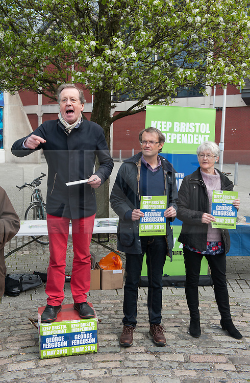 © Licensed to London News Pictures.23/04/2016. Bristol, UK.  GEORGE FERGUSON, the incumbent elected mayor of Bristol, on the election stump at Anchor Square launching his 7 point plan for if he wins the mayoral election on 05 May. Ferguson is standing as in independent under the Bristol First banner. His main rival is Labour candidate Marvin Rees. Ferguson was challenged and heckled at the event by independent mayoral candidate Paul Saville and opponents of the mayor held placards protesting about lack of transparency in the accounts for Bristol's year as Green Capital, and over the issue of disabled blue badge holders not being allowed to park in any residents parking zone space. Photo credit : Simon Chapman/LNP