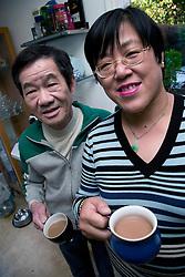 Older couple drinking tea,