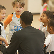 Coach Darion Jeralds talks to his team during Halo Basketball Saturday December 20, 2014 at Grace United Methodist Church in Wilmington, N.C. (Jason A. Frizzelle)